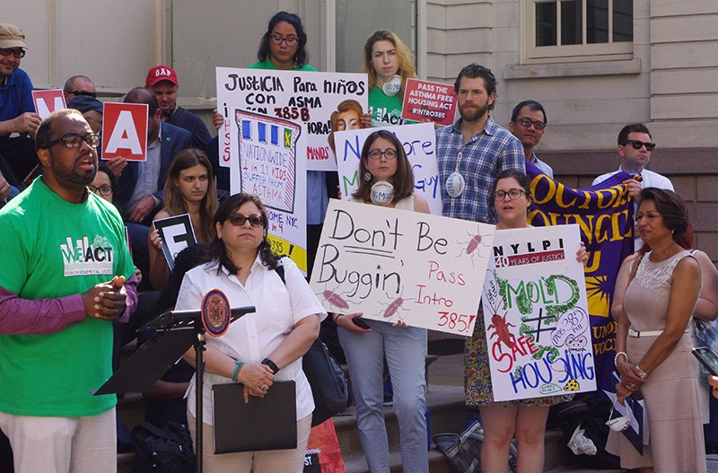 Demonstrators call for a healthy housing bill