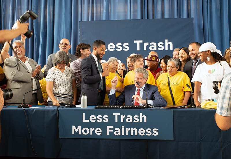 Mayor Bill de Blasio signs the bill