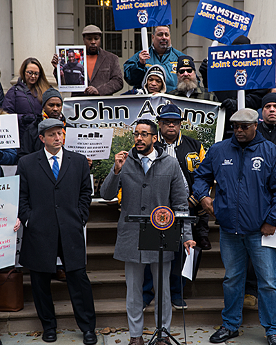 Councilmember Antonio Reynoso addresses a crowd to announce the closure of Sanitation Salvage on Nov 28, 2019
