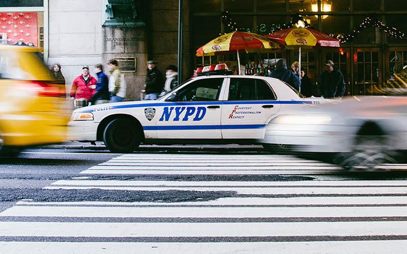 An NYPD car on a crosswalk