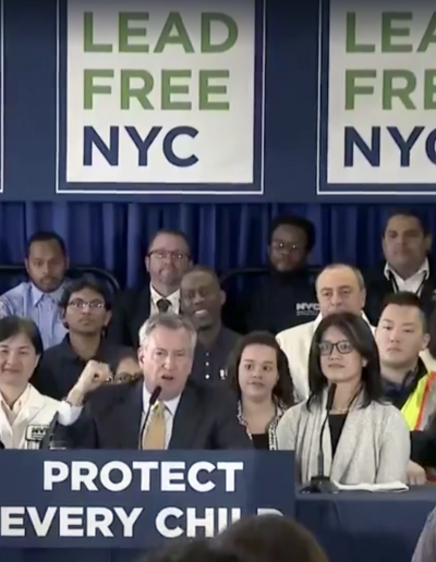"Mayor De Blasio announces ""Lead Free NYC"" plan, with NYLPI Director of Environmental Justice Rachel Spector (right) speaking"